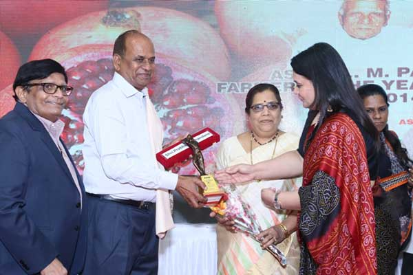 Awardee Shri. Prabhakar Chandane receiving the award by the hands of Chief Guest Dr. Purvi Mehta also seen Mrs. Chandane and Shri. Kiran Patel, Director Aspee Foundation